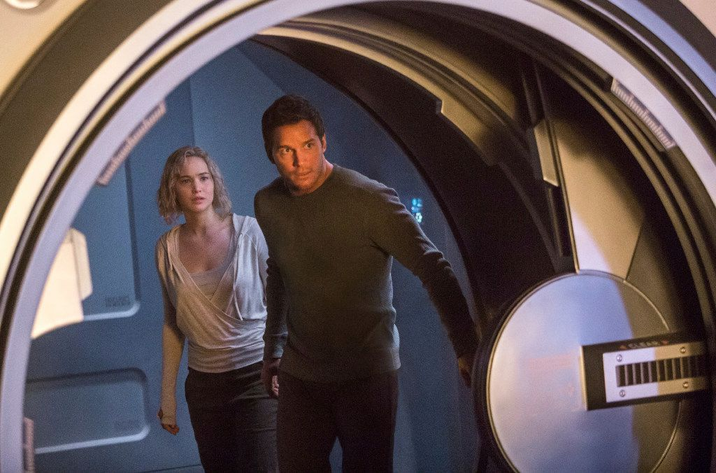 """This image released by Columbia Pictures, Jennifer Lawrence, left, and Chris Pratt in a scene from the film, Passengers."""""""
