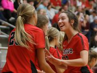 Flower Mound Marcus setter Maren Wisener (12) celebrates a Marauders score with teammate Maggie Boyd (20) during the first set of their match against Byron Nelson. The two teams played their Class 6A first round volleyball playoff match at Lewisville High School in Lewisville on October 29, 2018.