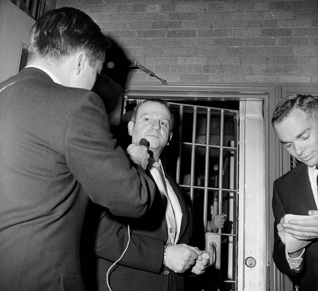 In this photos from Jan. 28, 1964, Jack Ruby talks to a reporter while being returned to jail after a psychiatric examination in Dallas. As Lee Harvey Oswald was being transferred from police headquarters to the county jail on Nov. 24, 1963, Ruby shot him in the chest from close range. Ruby was convicted of murder and sentenced to death. He appealed and was granted a new trial, but died of lung cancer before a trial date was set.
