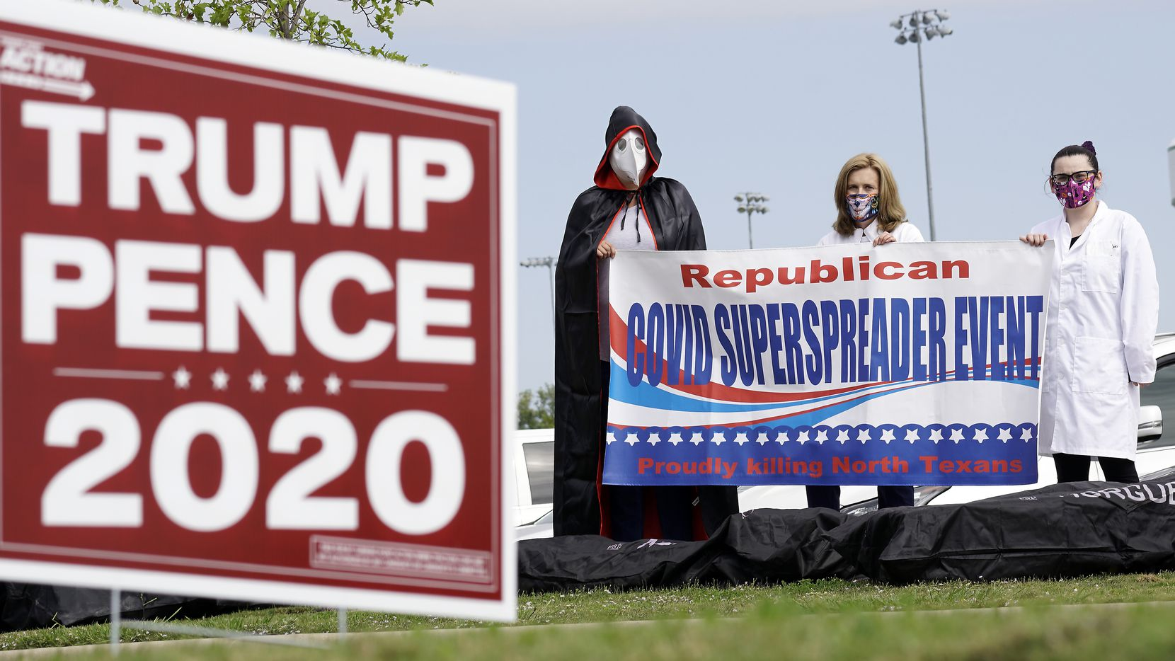 Members of Indivisible 24, a local chapter of the political progressive nonprofit, stand outside a Trump supporter event at The Marq in Southlake, Texas on Saturday, October 24, 2020.  (Lawrence Jenkins/Special Contributor)