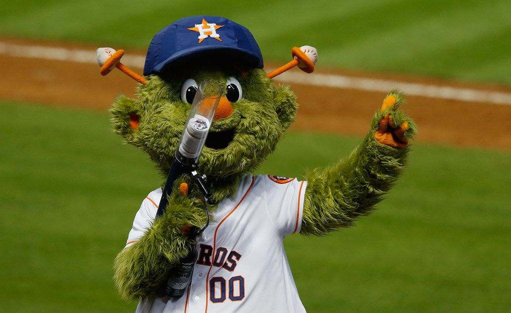 Houston Astros mascot Orbit prepares to fire a shirt into the crowd during a game against the Milwaukee Brewers at Minute Maid Park in 2013. The Major League Baseball team is being sued for more than $1 million by a woman who claims a shirt fired from the gun shattered her finger.