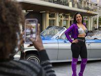 Clara Villalobos poses in the Selena outfit she made during the Selena's 50th birthday celebration at Jaxon Beer Garden.