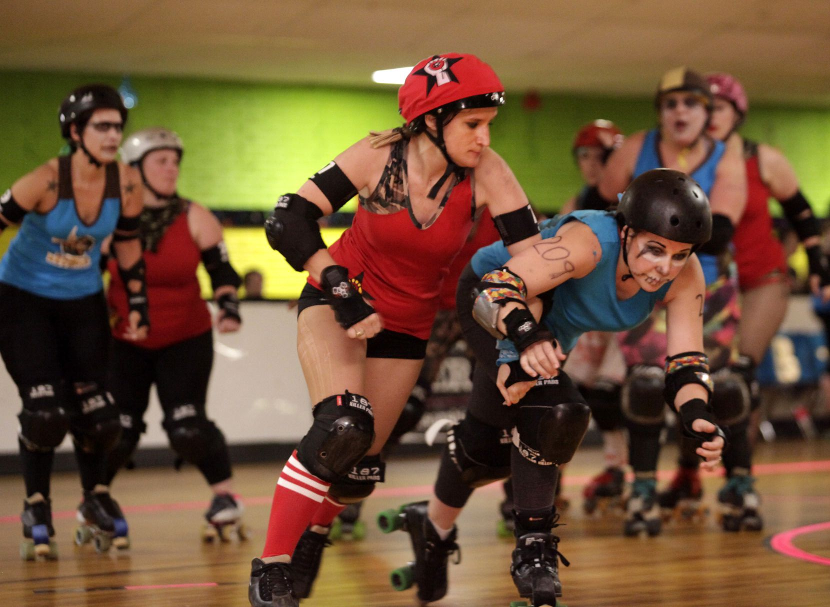Teams La Revolucion and Ruby's Revenge battled it out during an Assassination City Roller Derby competition at Thunderbird Roller Rink in Plano on June 20, 2015.