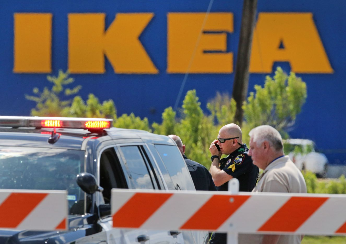Grand Prairie police officers are pictured on the scene of a confrontation with a man with a gun near the Ikea store.
