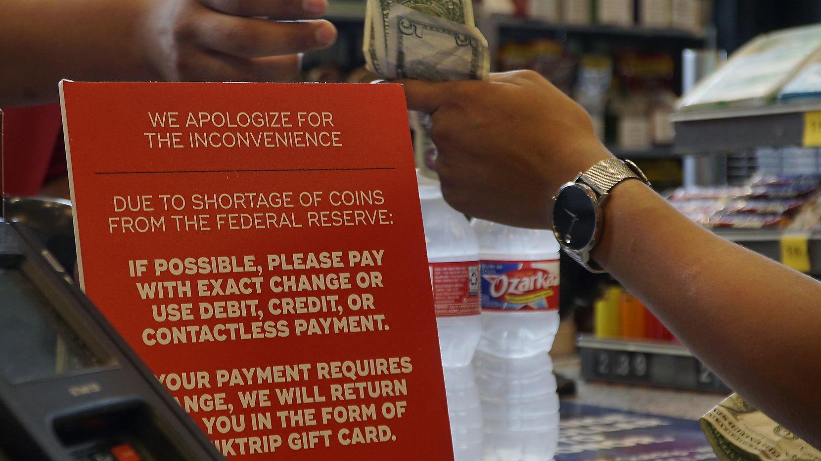 The QuikTrip on Davis Street in Dallas is using signs to let customers know there is a national coin shortage. The convenience store chain is asking customers to bring in their spare coins and receive cash in return so it can build up its coin deposit.