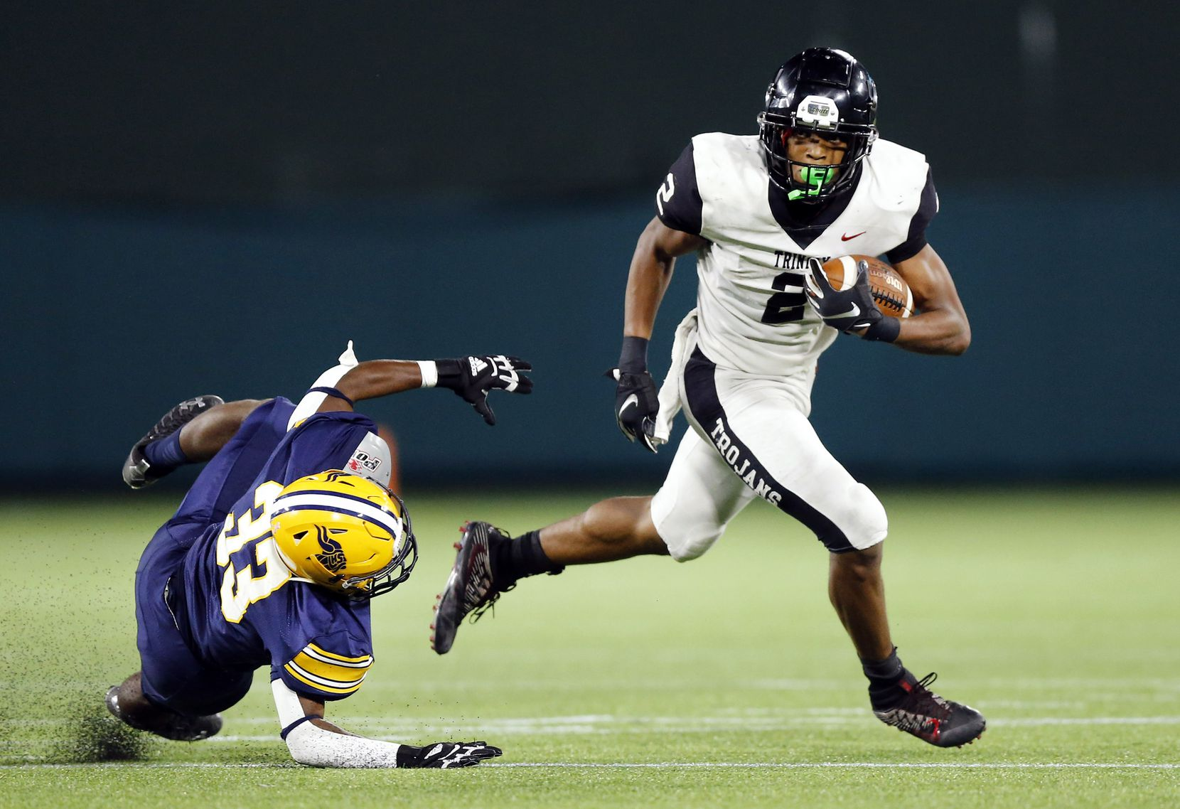 Euless Trinity's Ollie Gordon ran for 2,035 yards and 29 touchdowns last season and now moves from running back to quarterback. (Tom Fox/The Dallas Morning News)