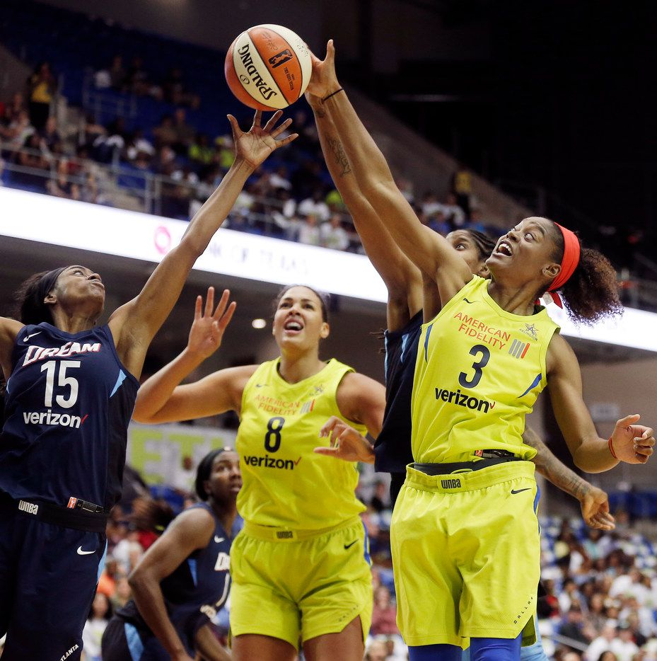 Atlanta Dream guard Tiffany Hayes (15) and Dallas Wings guard Kaela Davis (3) battle for a rebound during the first half of an WNBA basketball game at College Park Center in Arlington, Sunday, May 20, 2018. (Brandon Wade/Special Contributor)