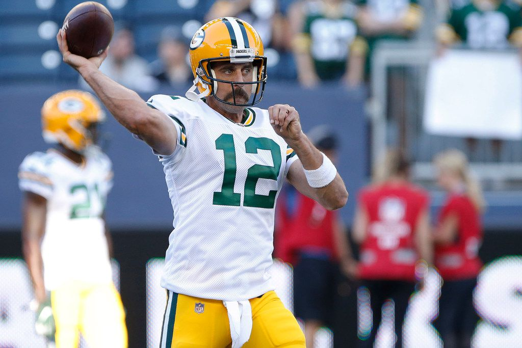 Green Bay Packers quarterback Aaron Rodgers warms up for the team's NFL preseason football game against the Oakland Raiders on Thursday, Aug. 22, 2019, in Winnipeg, Manitoba. (John Woods/The Canadian Press via AP)