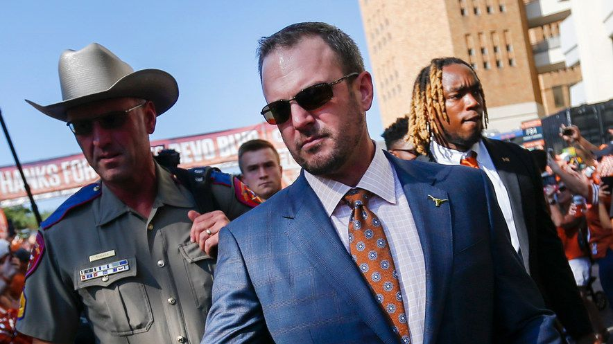 Texas Longhorns head coach Tom Herman greets fans as the team makes their way down Bevo Boulevard prior to a college football game between the University of Texas and Louisiana State University on Saturday, Sept. 7, 2019 at Darrell Royal Memorial Stadium in Austin, Texas.