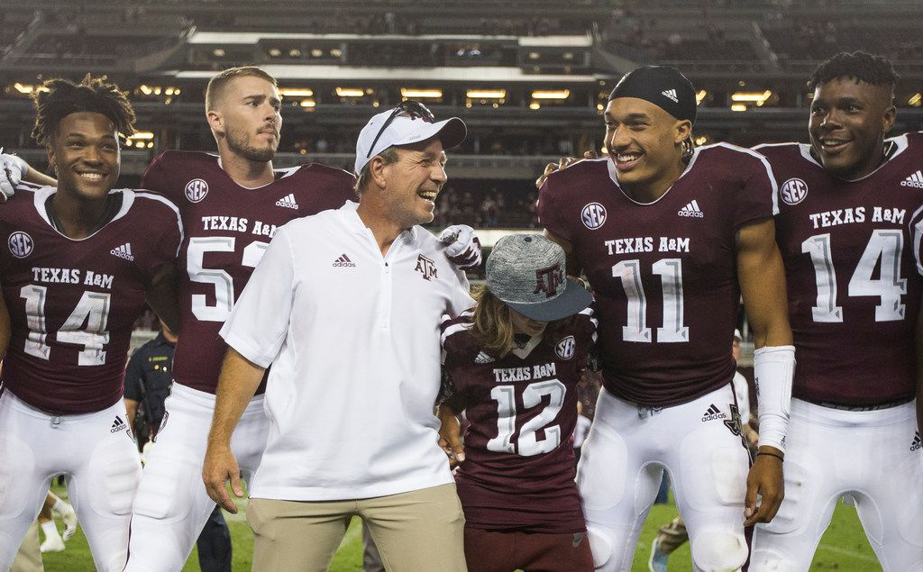 Texas A&M Aggies head coach Jimbo Fisher, joined by his son Ethan Fisher (wearing jersey number 12), celebrates with the team after beating the Northwestern State Demons 59-7 on Thursday, August 30, 2018 at Kyle Field in College Station, Texas. (Ryan Michalesko/The Dallas Morning News)