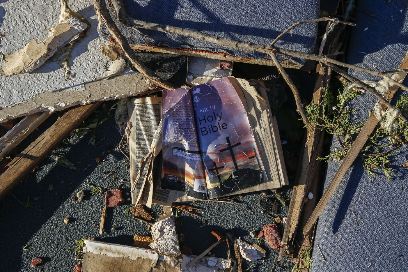 A bible is seen amongst the rubble at Primera Iglesia Bautista Mexicana church just off of Walnut Hill Lane in Dallas Oct. 21, 2019 after a tornado hit the night before.