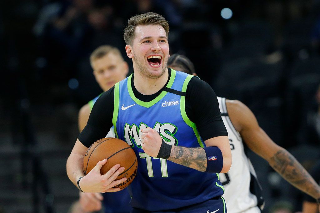 Dallas Mavericks guard Luka Doncic (77) reacts to a play during the second half of an NBA basketball game against the San Antonio Spurs in San Antonio, Wednesday, Feb. 26, 2020.