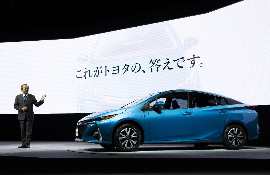 Takeshi Uchiyamada, chairman of Toyota Motor Corp., introduces the company's new Prius plug-in hybrid vehicle. (Tomohiro Ohsumi/Bloomberg)