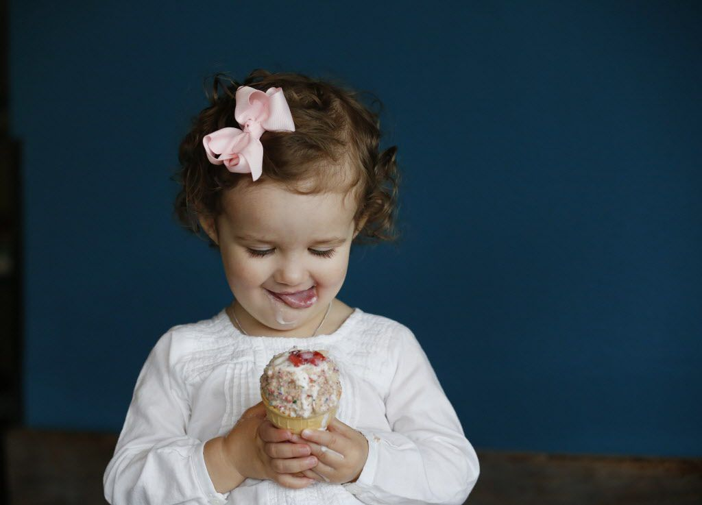 Blythe Durham, 1, of Dallas, eats ice cream while sitting for a portrait for The Dallas Morning News inside the Cow Tipping Creamery store located off Peavy Road in Dallas Thursday March 17, 2016. Cow Tipping Creamery started as food truck in Austin in 2012. The Dallas location, which has not yet opened, is the first storefront for the brand. The company is family-owned by Corey and Timothy Sorensen of Austin, and their son, Cole, 21, works out of the food truck. The store is located inside the Good 2 Go Taco shop. (Andy Jacobsohn/The Dallas Morning News)