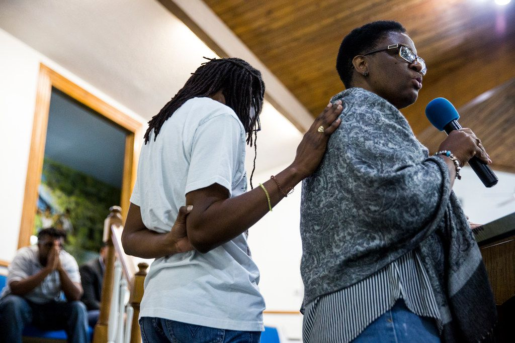 Allison Jean gives remarks about her son, Botham Shem Jean, as she is comforted by her daughter during a prayer vigil for her son at the Dallas West Church of Christ on Saturday, Sept. 8,in Dallas. He was shot by a Dallas police officer in his apartment on Thursday night.