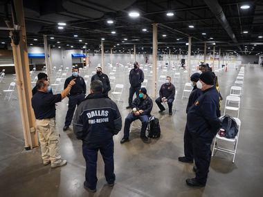 "Richard Esparza of Dallas County Health and Human Services briefs Dallas Fire Rescue personnel before the doors to open for people to receive the COVID-19 vaccine at Fair Park on Monday, Jan. 11, 2021, in Dallas. Dallas County launched its first ""mega"" public COVID-19 vaccination site Monday at Fair Park."