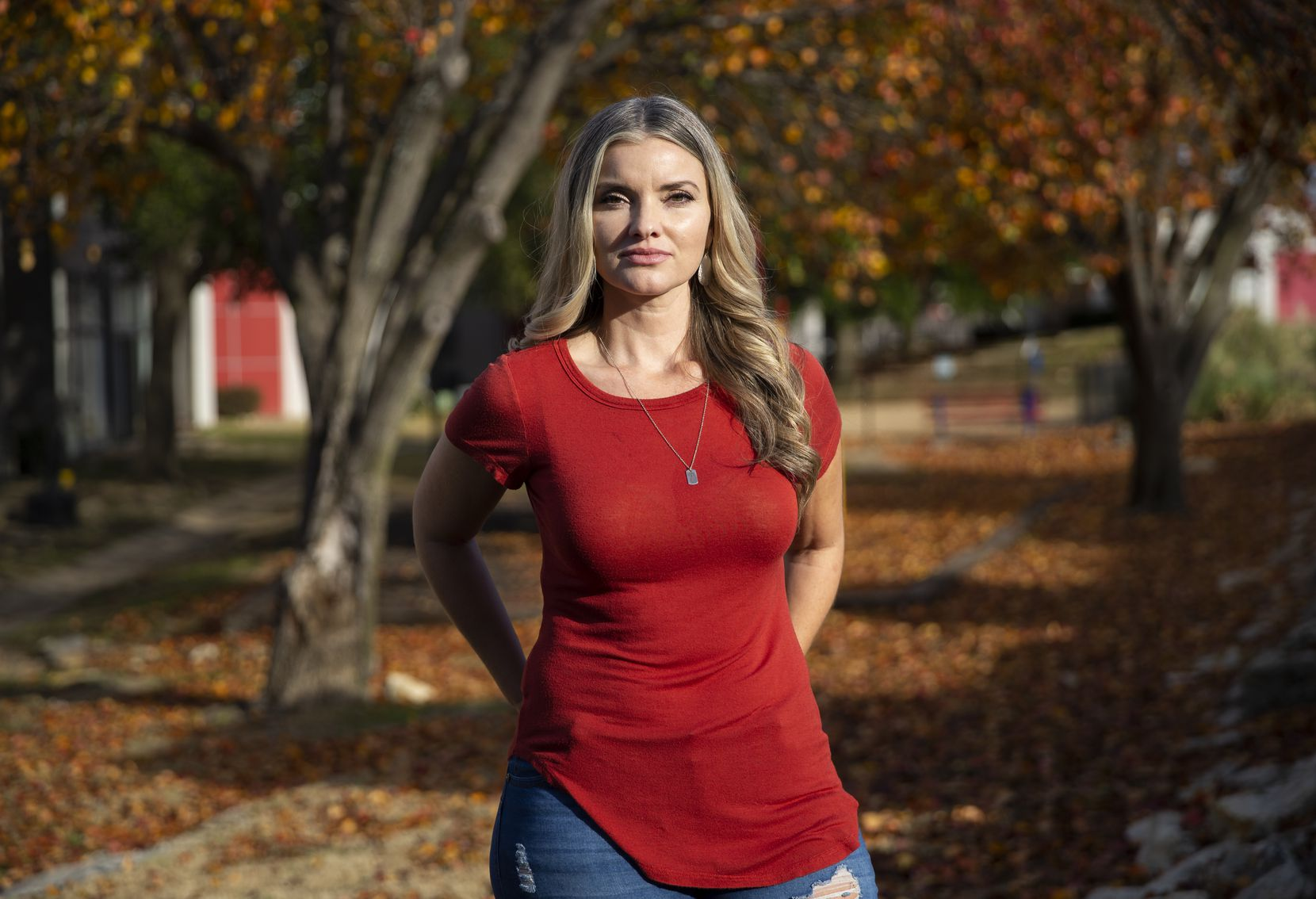 Jamie Nickerson poses outside of her home on Nov. 25, 2019 in Fort Worth. A July 2018 botched robbery at Veritex Community Bank on Merrick Street left her and two other employees injured. Nickerson still suffers from mental and physical trauma from the shooting. (Juan Figueroa/ The Dallas Morning News)
