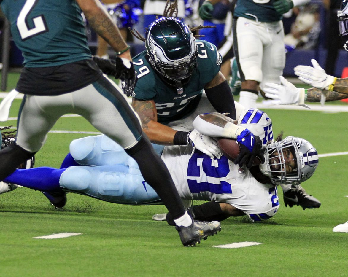 Dallas Cowboys running back Ezekiel Elliott (21) runs the ball insie the 5 yard-line, as Philadelphia Eagles free safety Avonte Maddox (29) makes the stop during the first half of a NFL football game at AT&T Stadium in Arlington on Monday, September 27, 2021. Elliot scored on the next play. (John F. Rhodes / Special Contributor)