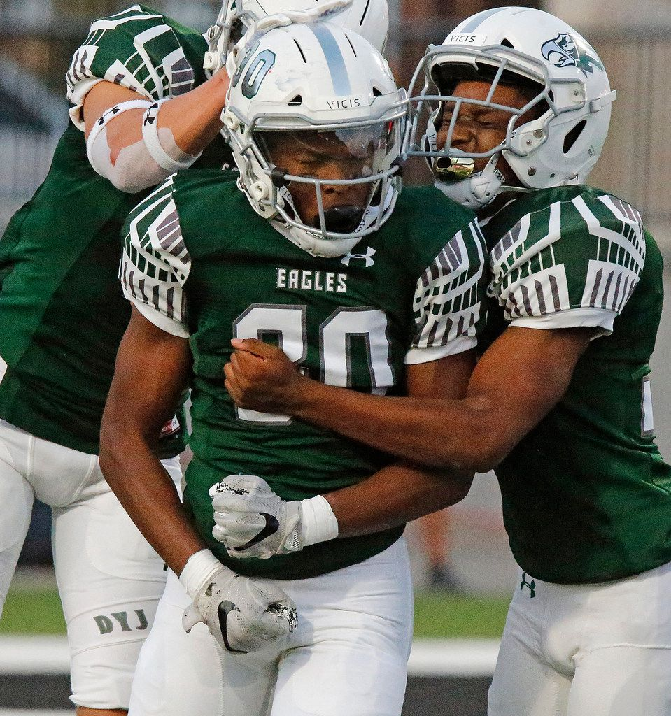 Prosper High School Bryson Propes (30) is congratulated by team mate Ryan Medeiros (16) and Miles Huggins (35) after making a big stop on the kickoff during the first half as Prosper High School hosted Rowlett High School in a non-district football game at Children's Health Stadium in Prosper on Friday, August 30, 2019. (Stewart F. House/Special Contributor)