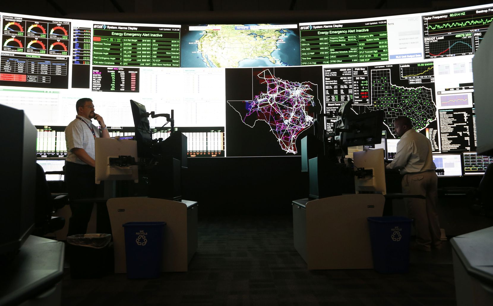 """System operators in the command center of the Electric Reliability Council of Texas in Taylor, shown in a 2018 file photo, should be considered among the essential workers who get COVID-19 shots early, council president and chief executive Bill Magness wrote to a state vaccine distribution panel. """"These workers keep the power flowing to critical customers such as hospitals and emergency facilities and their responders, and all other Texans located within the ERCOT footprint,"""" he said."""