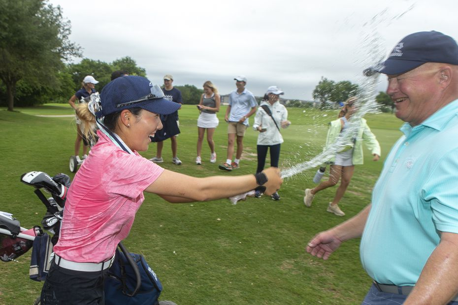 Carrollton Ranchview's Bohyun Park celebrates her third state title with head coach Kevin Kelson during the final day of the UIL Class 4A girls golf tournament in Kyle, Tuesday, May 11, 2021. (Stephen Spillman/Special Contributor)