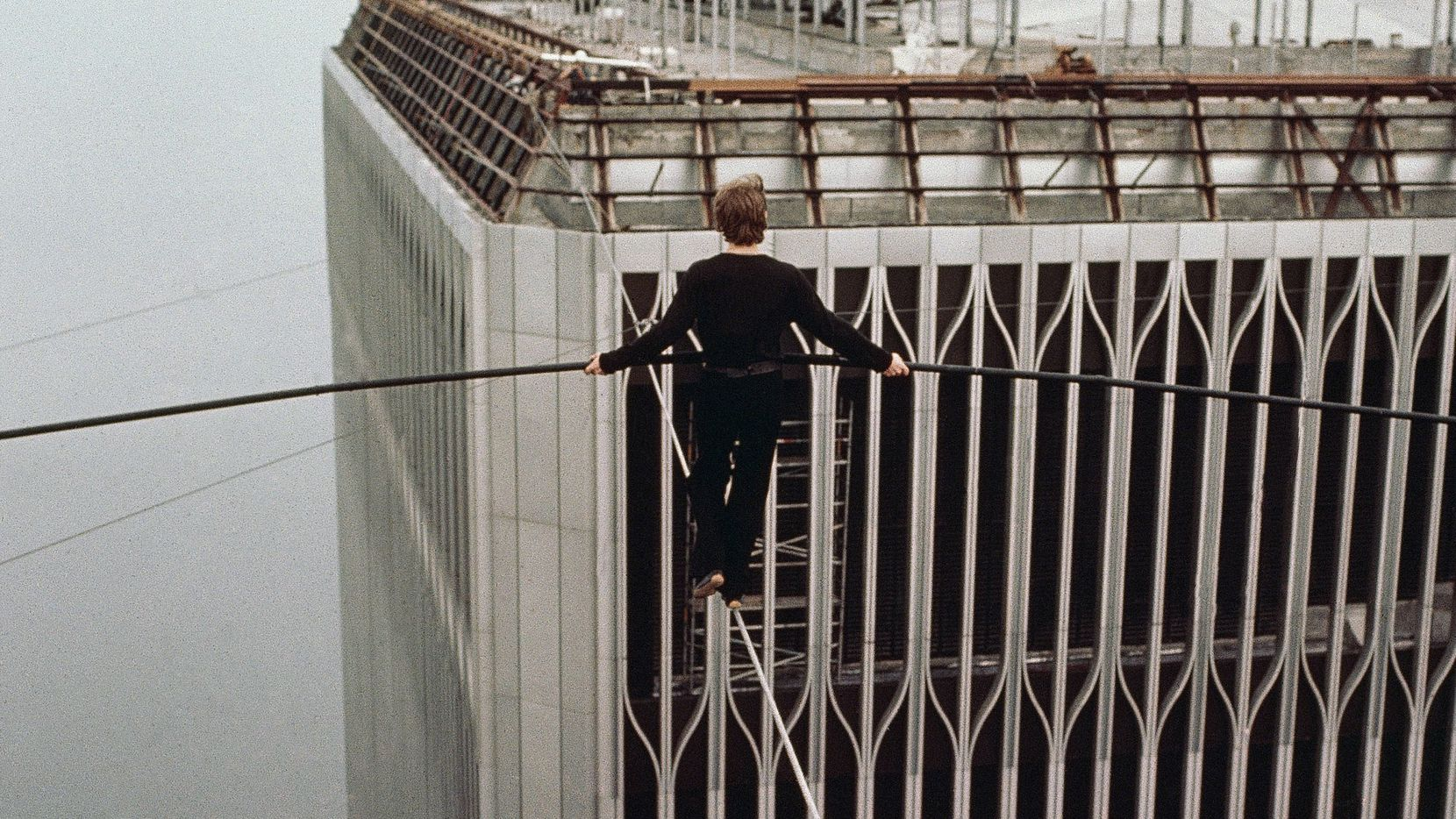French high-wire artist Philippe Petit walked a tightrope between the twin towers of the World Trade Center in New York City in 1974.
