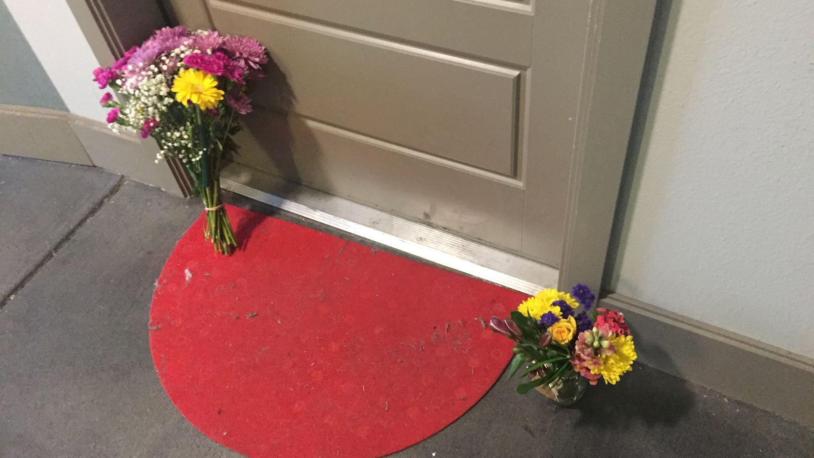 Flowers have ben placed at the front door of Botham Shem Jean, who Dallas police say was shot Thursday night by Amber Guyger, an off-duty police officer who mistakenly thought her apartment was his. Guyger was in uniform.