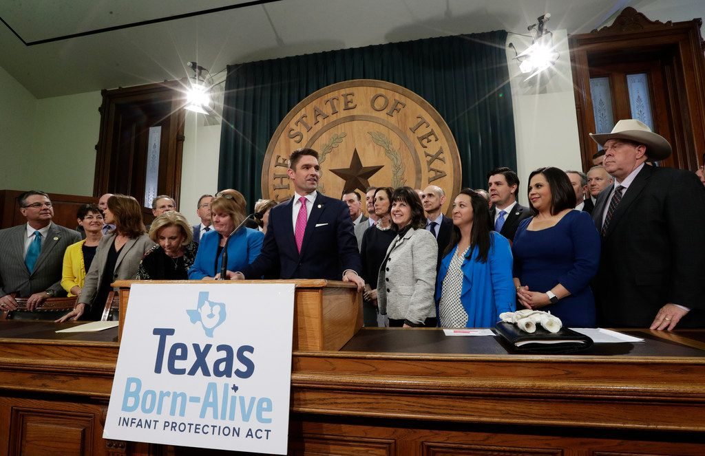 State Rep. Jeff Leach, at podium, stands with fellow lawmakers and guests to talk about the Texas Born-Alive bill, Thursday, March 7, 2019, in Austin, Texas.