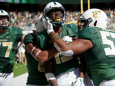 WACO, TX - NOVEMBER 3:  Denzel Mims #15 of the Baylor Bears celebrates with his teammates after scoring the game winning touchdown on a 6 yard reception against the Oklahoma State Cowboys during the second half of an NCAA football game at McLane Stadium on November 3, 2018 in Waco, Texas.  (Photo by Cooper Neill/Getty Images)