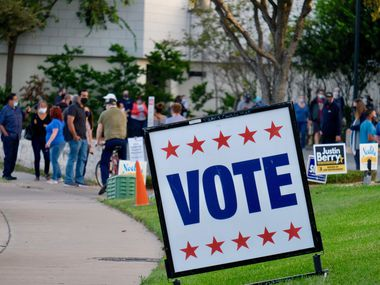 Long lines formed on the first day of early voting in Texas at Ben Hur Shrine Center in North Austin.