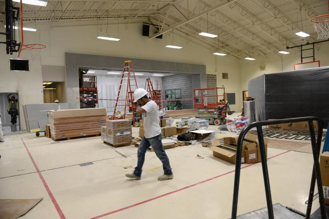 Construction workers renovate the gym at Hedgcoxe Elementary School in Plano. Hedgcoxe is just one of a number of school construction projects, totaling $57.1 million, now in progress to address maintenance needs and changes in classroom sizes at Plano ISD this summer.