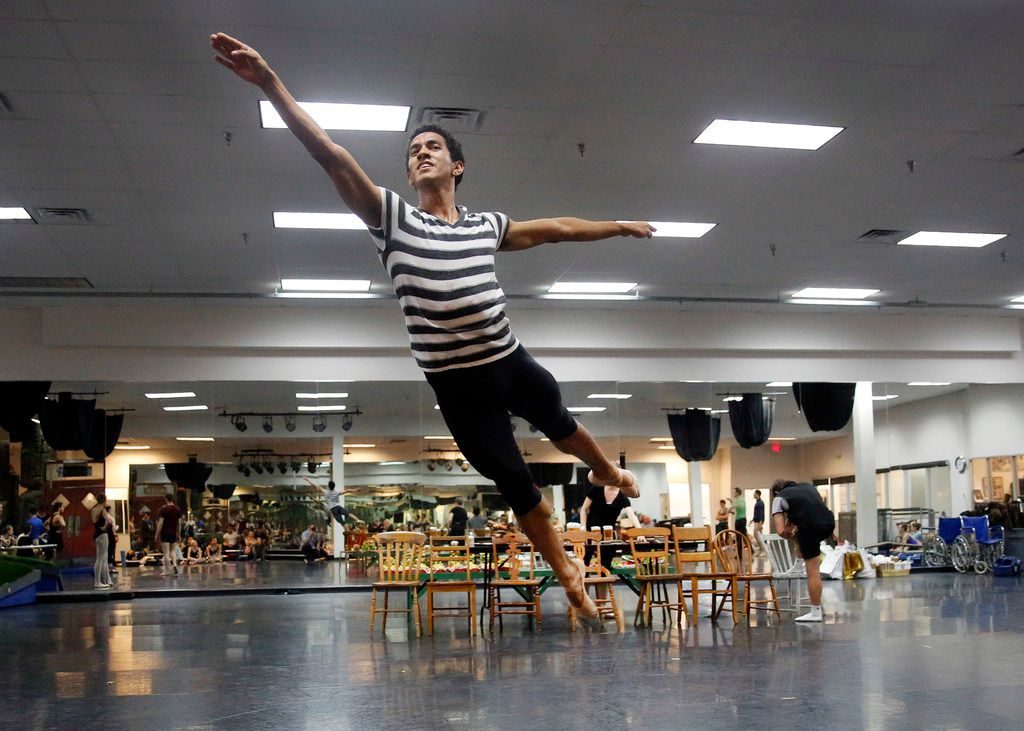 Joamanuel Velazquez as Pinocchio glides through the air as he rehearses at the Texas Ballet Theater studio in Fort Worth.