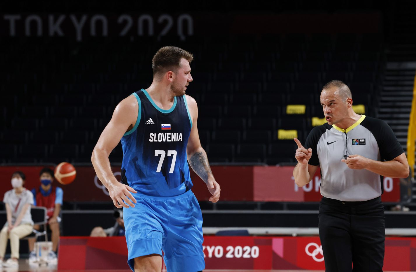 Slovenia's Luka Doncic (77) argues with an official in a game against Argentina in the first half of play during the postponed 2020 Tokyo Olympics at Saitama Super Arena on Monday, July 26, 2021, in Saitama, Japan. Slovenia defeated Argentina 118-100. (Vernon Bryant/The Dallas Morning News)