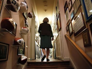 Alicia Landry walks down the hallway past some historical collections of her late husband, legendary Dallas Cowboys head coach Tom Landry, at her North Dallas home,  Tuesday, August 24, 2010.