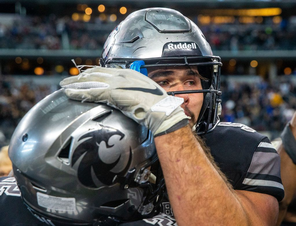 Denton Guyer offensive lineman Grant Mahon (center) cries after his team wins against Cedar Hill in the Class 6A Division II area-round high school football playoff game at the AT&T Stadium in Arlington, Texas, on Saturday, November 23, 2019. Denton Guyer beat Cedar Hill 50-41 in a major comeback after trailing by 27 points at halftime.  (Lynda M. Gonzalez/The Dallas Morning News)