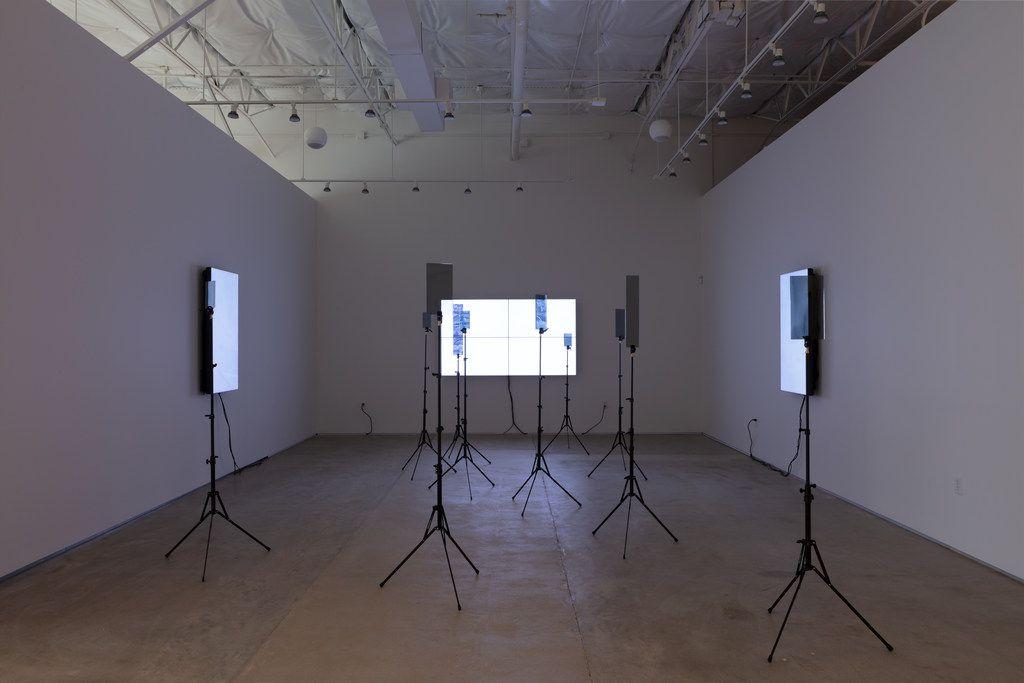 Emmanuel Van der Auwera Video Sculpture XX (World's 6th Sense), 2019; LCD screens, 10 x tripods with custom plexiglass, HD video variable