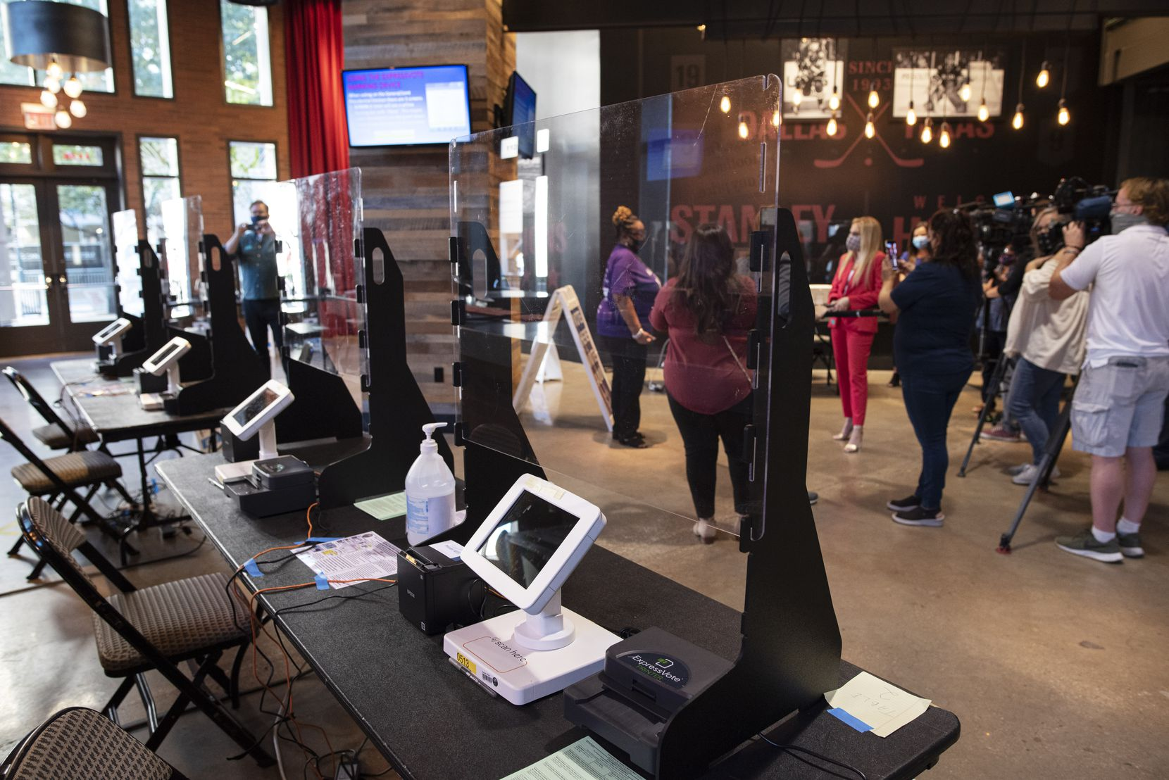 Voter check-in stations located inside a platinum level bar at the Dallas County Elections voting center inside the American Airlines Center in Dallas, on Monday, Oct. 12, 2020. The voting center has 20 check-in stations and 50 voting machines inside the AAC.