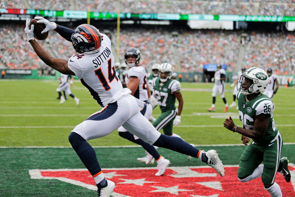 Denver Broncos' Courtland Sutton (14) catches a pass for a touchdown during the first half of an NFL football game against the New York Jets Sunday, Oct. 7, 2018, in East Rutherford, N.J. (AP Photo/Seth Wenig)