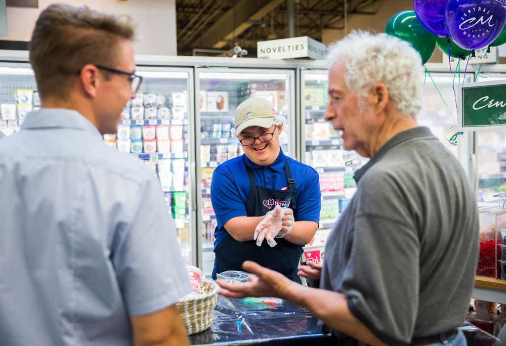 Coleman Jones (center), vice president of Howdy Homemade Ice Cream, hands out samples at Central Market on Lovers Ln on Sunday, July 21, 2019 in Dallas. (Ashley Landis/The Dallas Morning News)