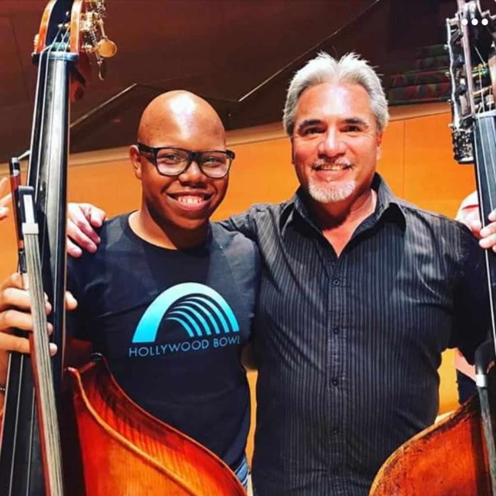 Draylen Mason, the 17-year-old killed in the second bombing in Austin, applied to attend University of North Texas in the double bass violin program. He is pictured with Oscar Meza, assistant principal bassist of the Los Angeles Philharmonic.