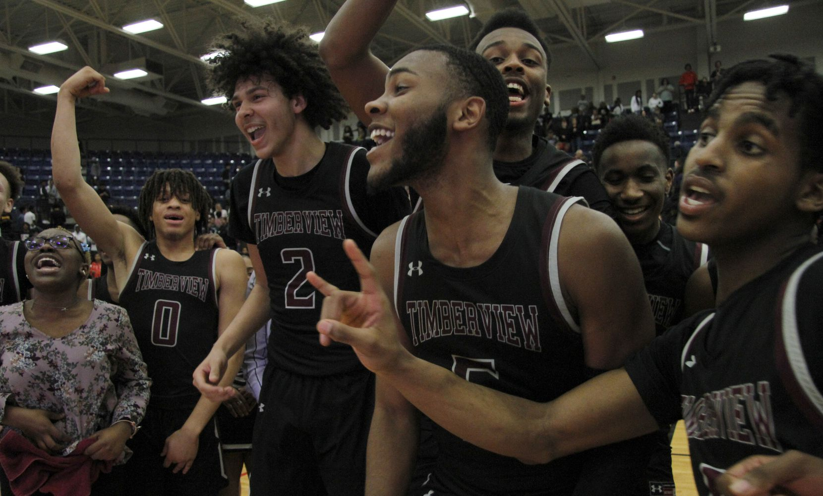 Members of the Mansfield Timberview varsity boys basketball team assemble at mid-court in celebration of their 41-40 overtime victory over Mansfield Legacy to advance. The two teams played in the Class 5A Region 1 quarterfinal boys basketball playoff game at Mansfield Lake Ridge High School in Mansfield on March 3, 2020.