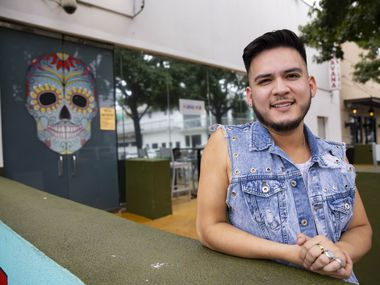 Mariano Pintor poses for a photo outside of Havana Lounge on Sunday, July 4, 2021, in Dallas. Havana was the first gay bar Pintor visited back in 2008 with his then boyfriend.