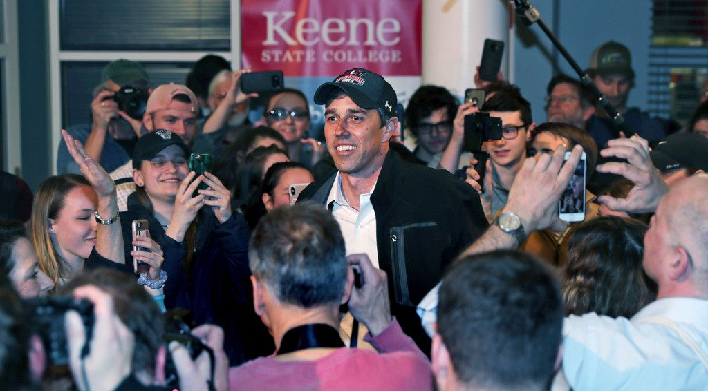 Former Texas congressman Beto O'Rourke smiles as he is surrounded while arriving for a campaign stop at Keene State College in Keene, N.H., Tuesday, March 19, 2019. O'Rourke announced last week that he'll seek the 2020 Democratic presidential nomination.