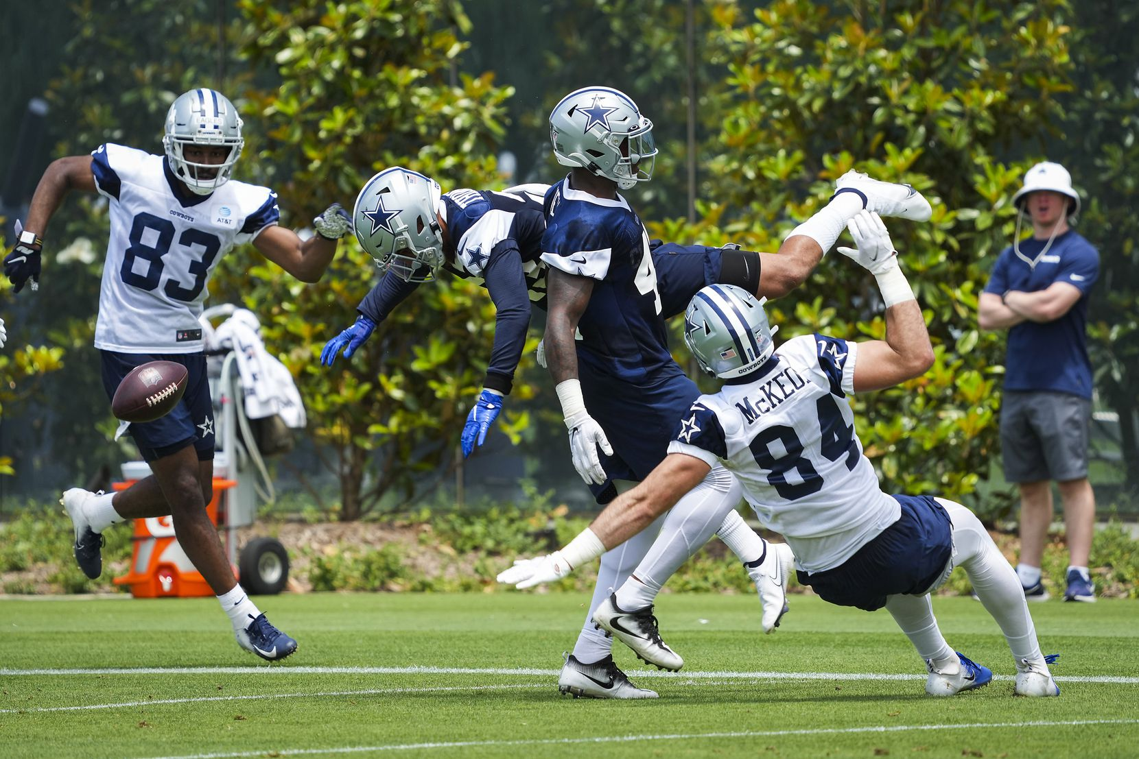 Dallas Cowboys safety Darian Thompson (23) leaps over tight end Sean McKeon (84), linebacker Keanu Neal (42) and wide receiver Brennan Eagles (83) to break up a pass during a minicamp practice at The Star on Tuesday, June 8, 2021, in Frisco. (Smiley N. Pool/The Dallas Morning News)