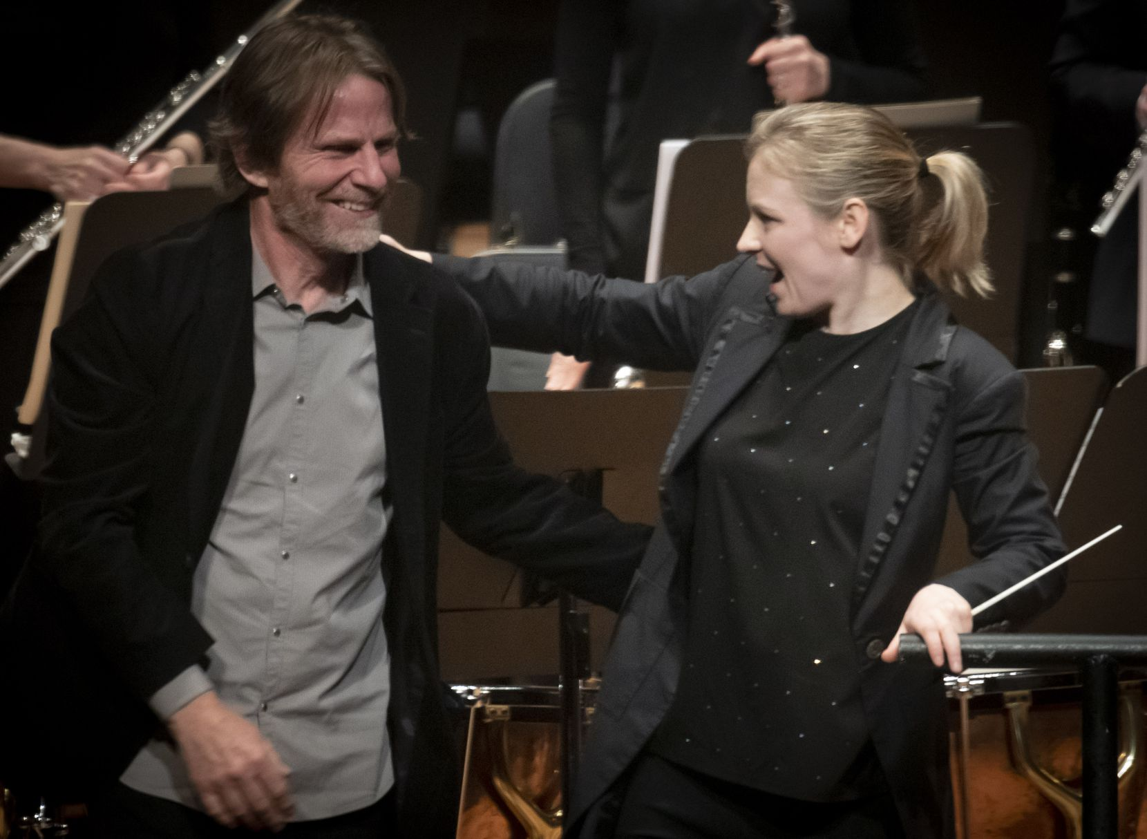 Composer Steven Mackey and the Dallas Symphony Orchestra's new principal guest conductor Gemma New congratulate each other after the world premiere of Mackey's Timpani Comcerto at the Meyerson Symphony Center on November 8, 2019.