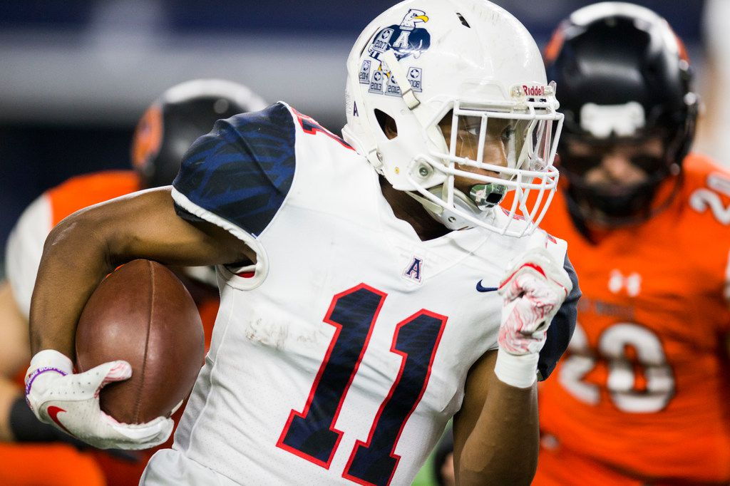 Allen running back Jordan Johnson (11) runs the ball to the end zone for a touchdown during the first quarter of a Class 6A Division I area-round high school football playoff game between Allen and Rockwall on Friday, November 22, 2019 at AT&T Stadium in Arlington. (Ashley Landis/The Dallas Morning News)