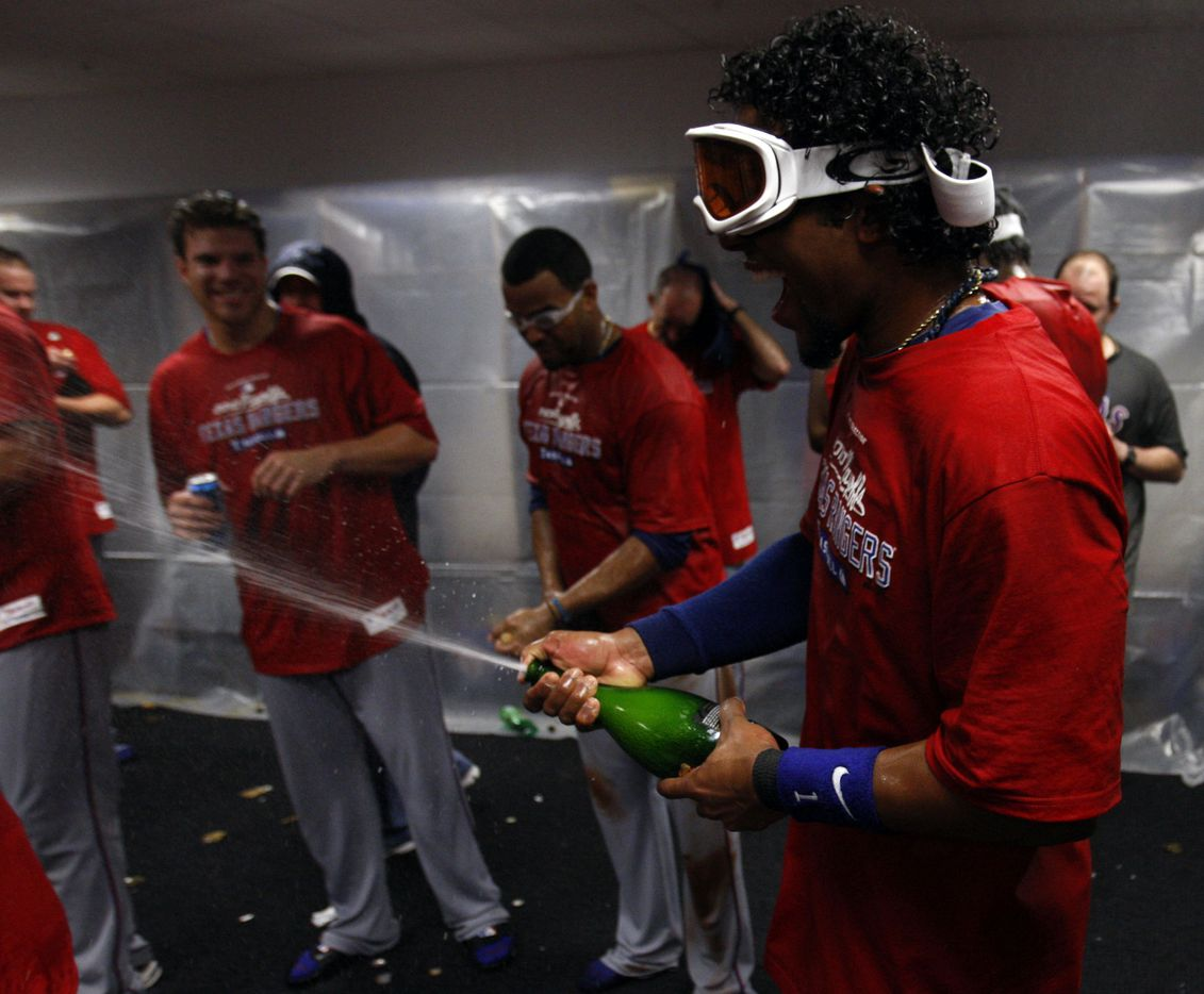 Texas Rangers Elvis Andrus sprays teammates after defeating the Tampa Bay Rays in game 5 of the American League Divisional Series at Tropicana Field in St. Petersburg, Florida on October 12, 2010. Rangers defeated the Rays 5-1 and advance to the ALCS. (Vernon Bryant/The Dallas Morning News)