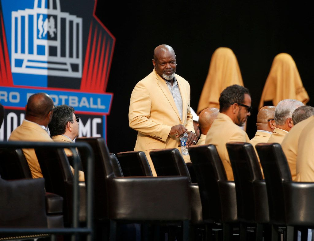 Former Dallas Cowboys player Emmitt Smith looks for his seat at the 2017 Pro Football Hall of Fame enshrinement ceremony in Canton, Ohio.