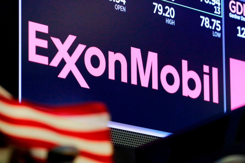 FILE - In this April 23, 2018, file photo, the logo for ExxonMobil appears above a trading post on the floor of the New York Stock Exchange.  Profit at Exxon Mobil Corp. surged on rising prices, but not enough for investors who are selling off shares in early trading.  The Irving, Texas-based company on Friday, July 27, 2018 reported second-quarter profit of $3.95 billion, or 92 cents per share.  (AP Photo/Richard Drew, File)