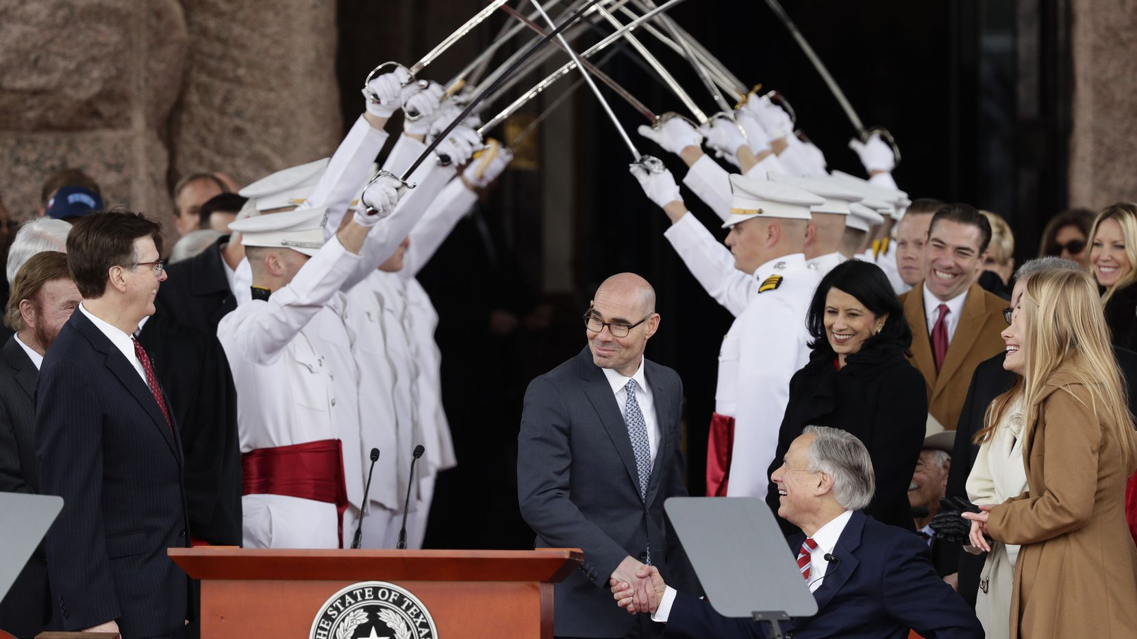 House Speaker Dennis Bonnen (center) congratulates Gov. Greg Abbott and Texas Lt. Gov. Dan Patrick (left) during their inauguration ceremony. These three have final say on what becomes law in Texas and what doesn't.